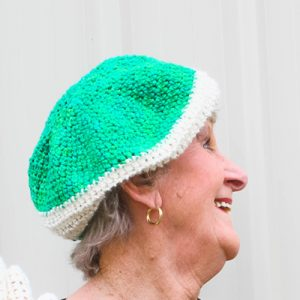 Inside Out Slouch Crochet Pattern by ReVe Design Co in Green & Cream - on model laughing
