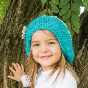 Berries & Cream Beanie Crochet Pattern in Turquoise & Bone on child's head from front