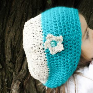 Berries & Cream Beanie Crochet Pattern in Turquoise & Bone on child's head from side