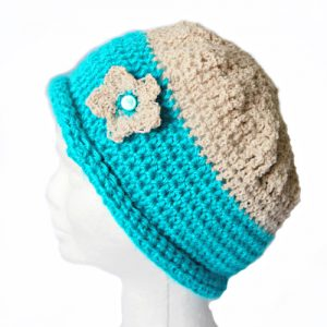 Berries & Cream Beanie Crochet Patternin Turquoise & Bone on head from side