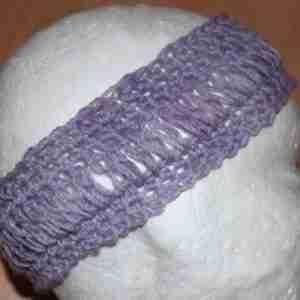 Loopy Headband Crochet Pattern by ReVe Design Co - US Terms - learn a brand new crochet stitch - mauve in wool version - on foam head