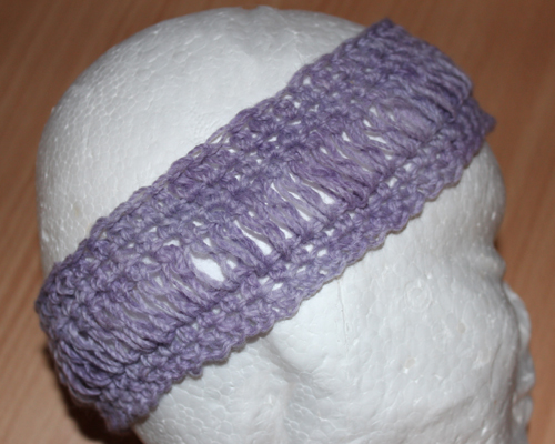 Loopy Headband Crochet Pattern by ReVe Design Co - US Terms - learn a brand new crochet stitch - mauve in wool version - on foam head