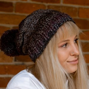 Bloomin' Comfy Beanie Crochet Pattern - With Pompom - cuff flat - on model from the side - closeup