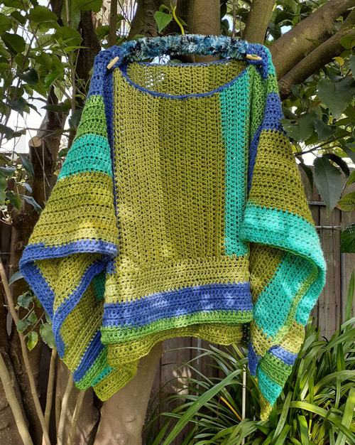 Sharon's Raindrops Poncho - hanging in a tree