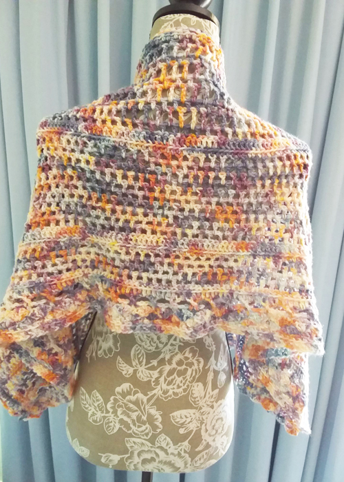 Spring in the Mountains Shawl - Great Southern Yarns 5ply - Rainclouds at Dawn - straight on manequin from back