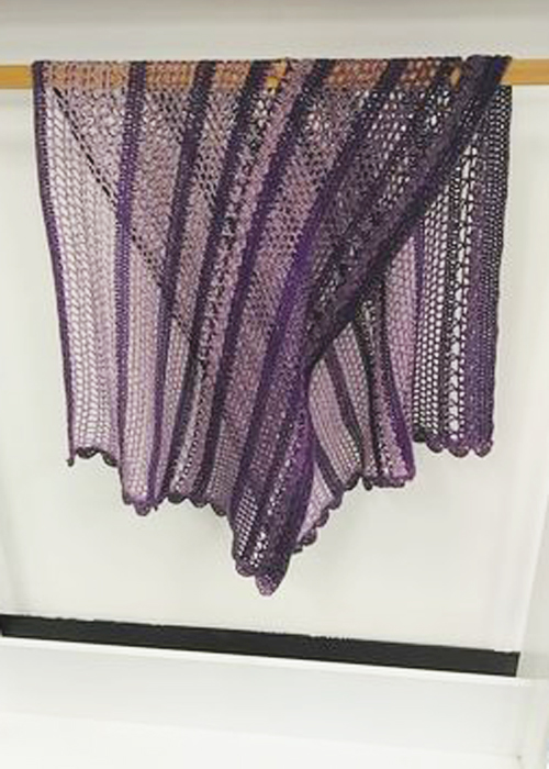 Spring in the Mountains Shawl - Purple Bobbel Boxx - hanging on rail