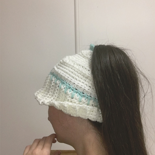 Early Morning Hair Hat Crochet Pattern by ReVe Design Co - from back on very long haired model - cuff half turned up - in white with teal accents