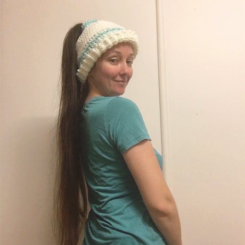 Early Morning Hair Hat Crochet Pattern by ReVe Design Co - from side on very long haired model - cuff turned up - in white with teal accents 2