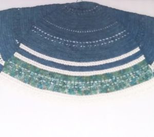Adalia Semi-Circle Shawl in Deep Sea Colours - Flat lay with ends folded to middle